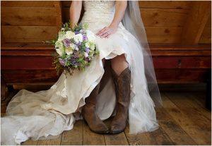 bride in cowboy boots, bridal portrait, bridal bouquet, wedding flowers, wedding dress and veil,evergreen barn wedding, mountain wedding planner, wedding planning colorado, rustic elegance