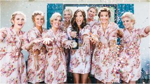 scottsdale wedding planner, bride getting ready, arizona weddings, bridesmaids, floral robes, popping champagne
