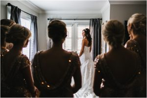 scottsdale wedding planner, bride getting ready, arizona weddings, bride putting on dress, bridesmaids looking on