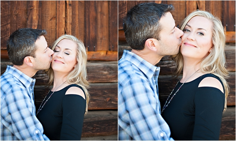 couple kissing in front of old wooden barn,clear creek history park, golden colorado engagement session, autumn, l elizabeth events, colorado engagement photography, mountain engagement photographer