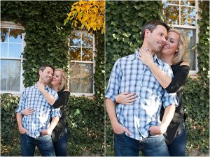 couple hugging in front of vine covered house,clear creek history park, golden colorado engagement session, autumn, l elizabeth events, colorado engagement photography, mountain engagement photographer