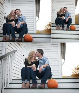 couple kissing with pumpkin on steps of historic white wooden building,clear creek history park, golden colorado engagement session, autumn, l elizabeth events, colorado engagement photography, mountain engagement photographer