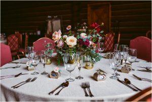 reception decor, centerpieces, floral details, table numbers, dao house, estes park, colorado wedding planner, mountain wedding coordination