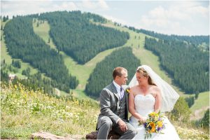 bride and groom portrait in front of ski slopes, donavan pavilion vail, colorado wedding photography, mountain wedding photographer