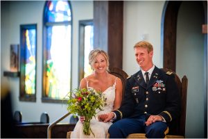bride and groom sitting on the altar during ceremony,church ceremony, steamboat springs, mountain wedding, colorado wedding photographer