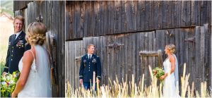 bride and groom portraits, looking at one another, tall grass, old wood barn, steamboat springs, colorado wedding photography, mountain wedding photographer