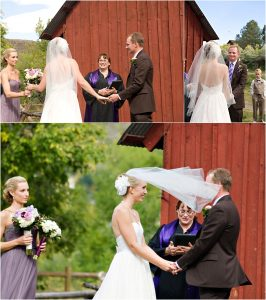 outdoor ceremony in front of rustic red barn at clear creek history park, bride's veil blowing in the wind, bride and groom, reverend kim tavendale wedding officiant, colorado wedding photographer