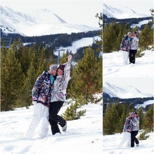 couple celebrating, couple in snow on mountaintop,winter snowboarding proposal, beaver run resort, surprise proposal, colorado photographer, proposal photography, mountain wedding photographer, summit county