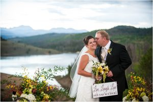 bride and groom with sign, couples portraits, mountain lake view,C Lazy U Ranch, Granby, Colorado, Rustic Ranch Wedding, Colorado Wedding Planner, Mountain Wedding Photographer