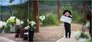 ring bearer walking down the aisle, outdoor ceremony, recessional,C Lazy U Ranch, Granby, Colorado, Rustic Ranch Wedding, Colorado Wedding Planner, Mountain Wedding Photographer