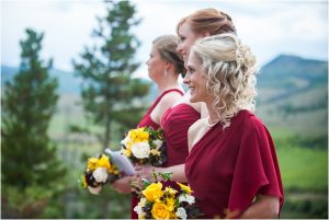 bridesmaids standing at ceremony during processional,C Lazy U Ranch, Granby, Colorado, Rustic Ranch Wedding, Colorado Wedding Planner, Mountain Wedding Photographer, outdoor ceremony, woodsie ceremony site