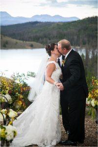 first kiss, bride and groom, ceremony, woodsie outdoor mountain ceremony site,C Lazy U Ranch, Granby, Colorado, Rustic Ranch Wedding, Colorado Wedding Planner, Mountain Wedding Photographer