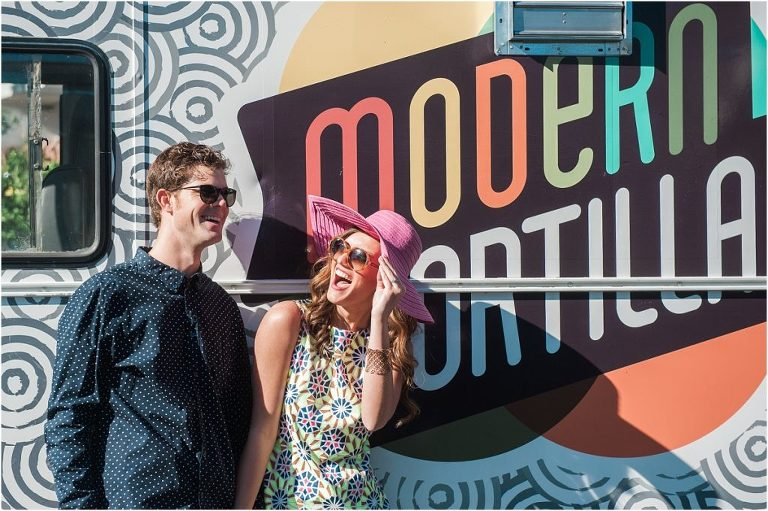 couple laughing in front of modern tortilla food truck, pink floppy hat,hotel valley ho, scottsdale, arizona, styled shoot, engagement session, food trucks, wedding weekend, pool party, phoenix wedding planner, event design