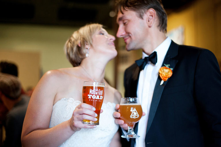 bride + groom, couple holding mountain toad beers