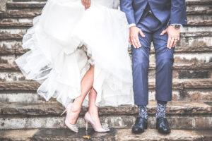 married couple showing their shoes, socks.ask the wedding experts, wedding planning event