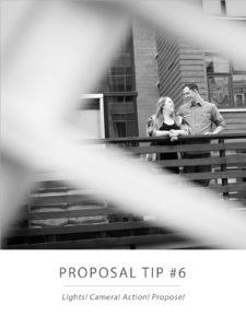 engaged couple sitting on a bridge