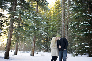 couple kissing in the snow, proposal tip 1